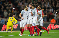 Celebrations as Adam Lallana(left)  (Liverpool) of England scores from the penalty spot during the International Friendly match between England and Spain at Wembley Stadium, London, England on 15 November 2016. Photo by Andy Rowland.