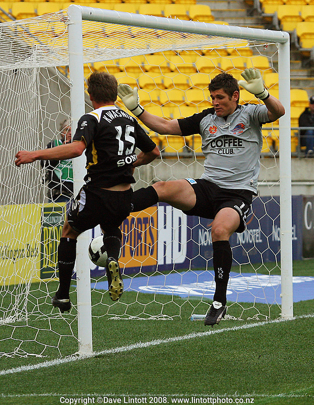 Adam Kwasnik's shot is blocked by Liam Reddy during the A-League football match between the Wellington Phoenix and Queensland Roar at Westpac Stadium, Wellington. Sunday, 26 October 2008. Photo: Dave Lintott / lintottphoto.co.nz