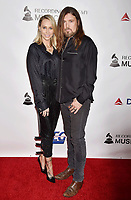 LOS ANGELES, CA - FEBRUARY 08: Tish Cyrus (L) and Billy Ray Cyrus attend MusiCares Person of the Year honoring Dolly Parton at Los Angeles Convention Center on February 8, 2019 in Los Angeles, California.<br /> CAP/ROT/TM<br /> &copy;TM/ROT/Capital Pictures