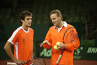 7-2-06, Netherlands, Amsterdam, Daviscup, first round, Netherlands-Russia, training ,Coach Tjerk Bogtstra (r) and John van Lottum eveluate
