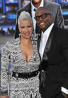 Terry Crews &amp; wife at the Los Angeles premiere of his movie &quot;Draft Day&quot; at the Regency Village Theatre, Westwood.<br /> April 7, 2014  Los Angeles, CA<br /> Picture: Paul Smith / Featureflash