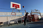 Palestinian girls attend a training session in the basketball stars academy, in Gaza city on March 10, 2019. The Academy is a team of trainers and teachers specialized in the training of boys and girls basketball, as well as their scientific and medical development. Photo by Mahmoud Ajjour