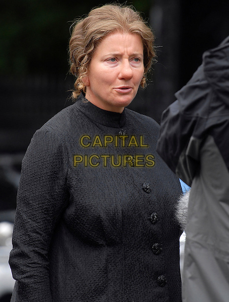 """EMMA THOMPSON.Filming on the set of """"Nanny McPhee and the Big Bang"""", Regent Crescent, London, England..July 19th, 2009.half length black jacket make-up prosthetic nose  .CAP/IA.©Ian Allis/Capital Pictures."""