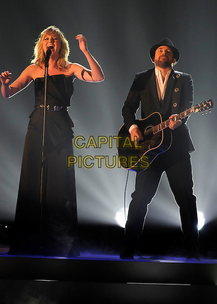 JENNIFER NETTLES & KRISTIAN BUSH OF SUGARLAND .performs during the 43rd Annual CMA Awards, Country Music's Biggest Night, held at the Sommet Center, Nashville, Tennessee, USA, 11th November 2009. live show on stage full length concert gig music black strapless dress guitar microphone band group singing playing cowboy hat long maxi suit waist belt arms .CAP/ADM/LF.©Laura Farr/AdMedia/Capital Pictures.