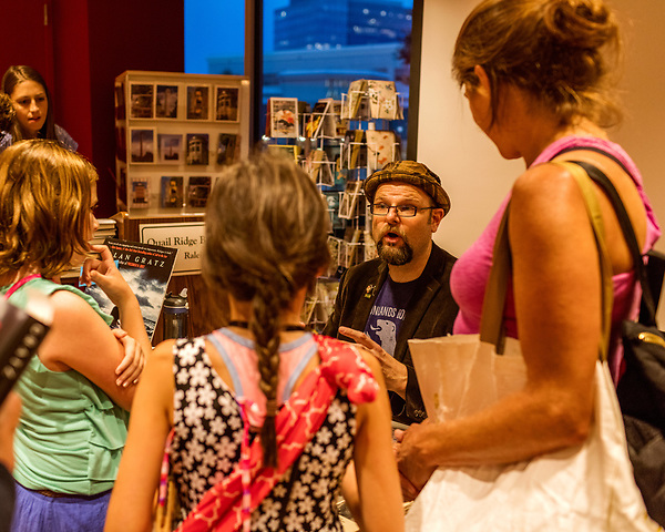 July 26, 2017. Raleigh, North Carolina.<br /> <br /> Alan Gratz speaks to his fans. <br /> <br /> Author Alan Gratz spoke about and signed his new book &quot;Refugee&quot; at Quail Ridge Books. The young adult fiction novel contrasts the stories of three refugees from different time periods, a Jewish boy in 1930's Germany , a Cuban girl in 1994 and a Syrian boy in 2015.