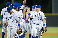 Chris DeVito (34) of the Burlington Royals high fives his teammates after their win over the Princeton Rays at Burlington Athletic Stadium on August 12, 2016 in Burlington, North Carolina.  The Royals defeated the Rays 9-5.  (Brian Westerholt/Four Seam Images)