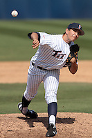 Christian Coronado #27 of the Cal State Fullerton Titans pitches against the TCU Horned Frogs at Goodwin Field on February 26, 2012 in Fullerton,California. Fullerton defeated TCU 11-10.(Larry Goren/Four Seam Images)