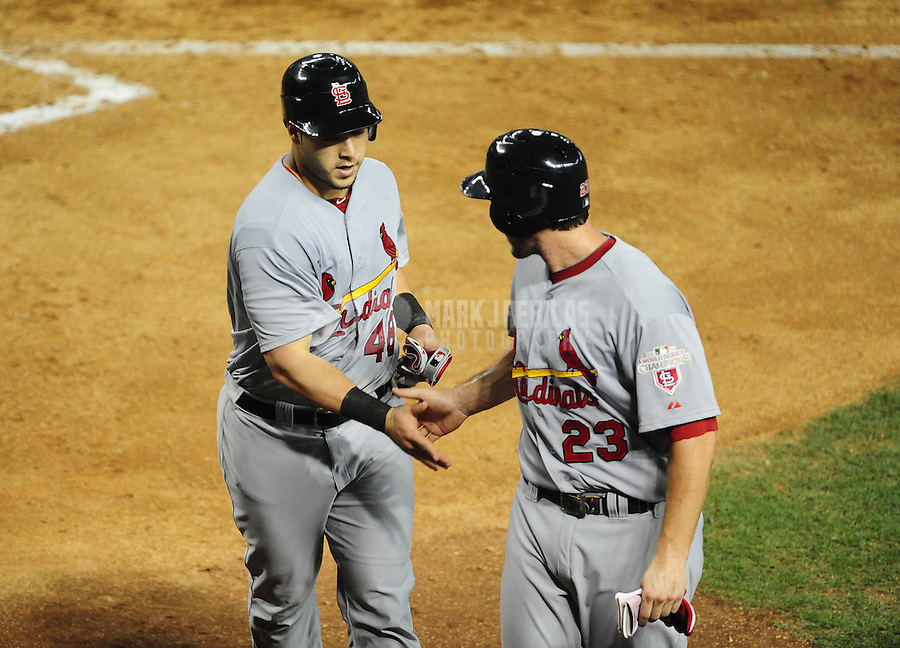 May 9, 2012; Phoenix, AZ, USA; St. Louis Cardinals catcher Tony Cruz (left) celebrates with David Freese after scoring in the sixth inning against the Arizona Diamondbacks at Chase Field. The Cardinals defeated the Diamondbacks 7-2. Mandatory Credit: Mark J. Rebilas-