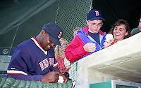 Boston Red Sox Mo Vaughn signs autographs during Spring Training at Dunedin Stadium in Dunedin, Florida in 1993.  (MJA/Four Seam Images)