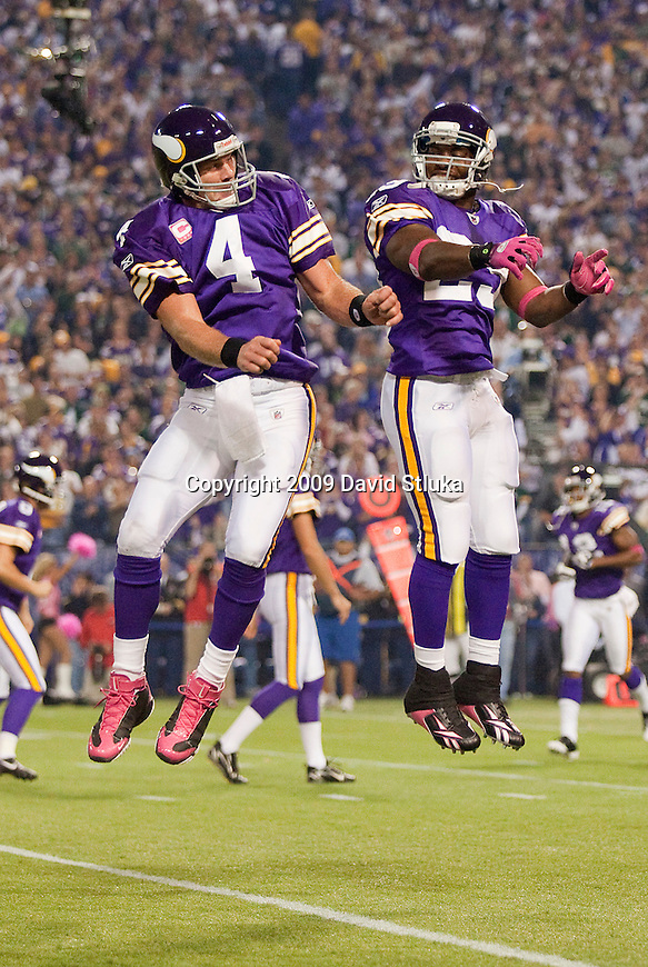 Minnesota Vikings quarterback Brett Favre (4) and running back Chester Taylor (29) celebrate a touchdown during an NFL football game against the Green Bay Packers at the Hubert H. Humphrey Metrodome on October 5, 2009 in Minneapolis, Minnesota. The Vikings won 30-23. (AP Photo/David Stluka)