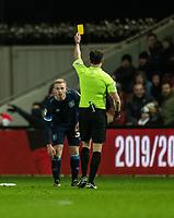 Huddersfield Town's Lewis O'Brien (left) is shown a yellow card by referee Darren England<br /> <br /> Photographer David Horton/CameraSport<br /> <br /> The EFL Sky Bet Championship - Bristol City v Huddersfield Town - Saturday 30th November 2019 - Ashton Gate Stadium - Bristol<br /> <br /> World Copyright © 2019 CameraSport. All rights reserved. 43 Linden Ave. Countesthorpe. Leicester. England. LE8 5PG - Tel: +44 (0) 116 277 4147 - admin@camerasport.com - www.camerasport.com