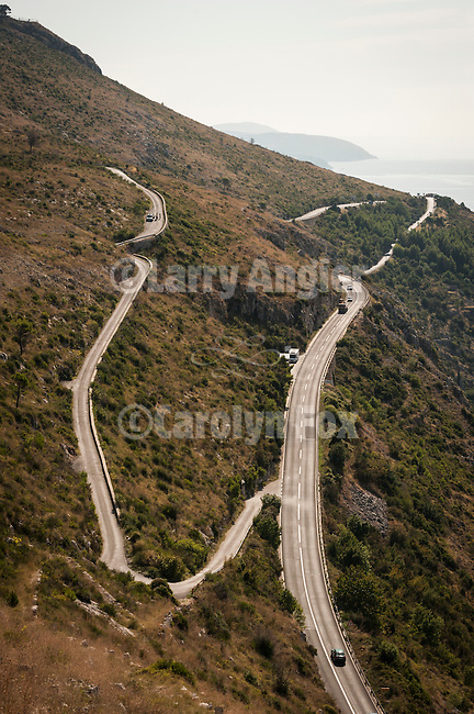 WInding road looking south on the way from Cavtat to the walled city (stari grad) of Duvbrovnik, founded c. 972 along the Dalmatian Coast on the Adriatic Sea in Croatia