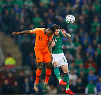 16th November 2019; Windsor Park, Belfast, Antrim County, Northern Ireland; European Championships 2020 Qualifier, Northern Ireland versus Netherlands; Quincy Promes of Netherlands and Stuart Dallas of Northern Ireland challenge for the high ball - Editorial Use