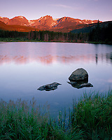Rocky Mountain National Park, CO<br /> Sunrise on Otis Peak and Flattop Mountain with  reflections on Sprague Lake