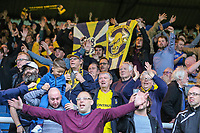 Oxford United supporters celebrate after victory in the Sky Bet League 1 match between Peterborough and Oxford United at the ABAX Stadium, London Road, Peterborough, England on 30 September 2017. Photo by David Horn.