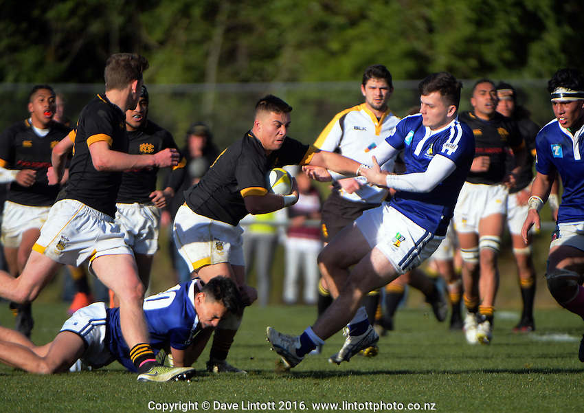 Action from the Wellington Secondary Schools rugby final between Wellington College (black, yellow and white) and St Patrick's College Town (blue and white) at Jerry Collins Stadium, Wellington, New Zealand on Sunday, 14 August 2016. Photo: Dave Lintott / lintottphoto.co.nz