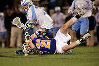 Baltimore, MD - April 5: Hopkins Face-off specialist Drew Kennedy #76  lays out Defensemen Kevin Harris # 21 of the Albany Great Dane's during the Albany v Johns Hopkins mens lacrosse game at  Homewood Field on April 5, 2012 in Baltimore, MD. (Ryan Lasek/Eclipse Sportswire)