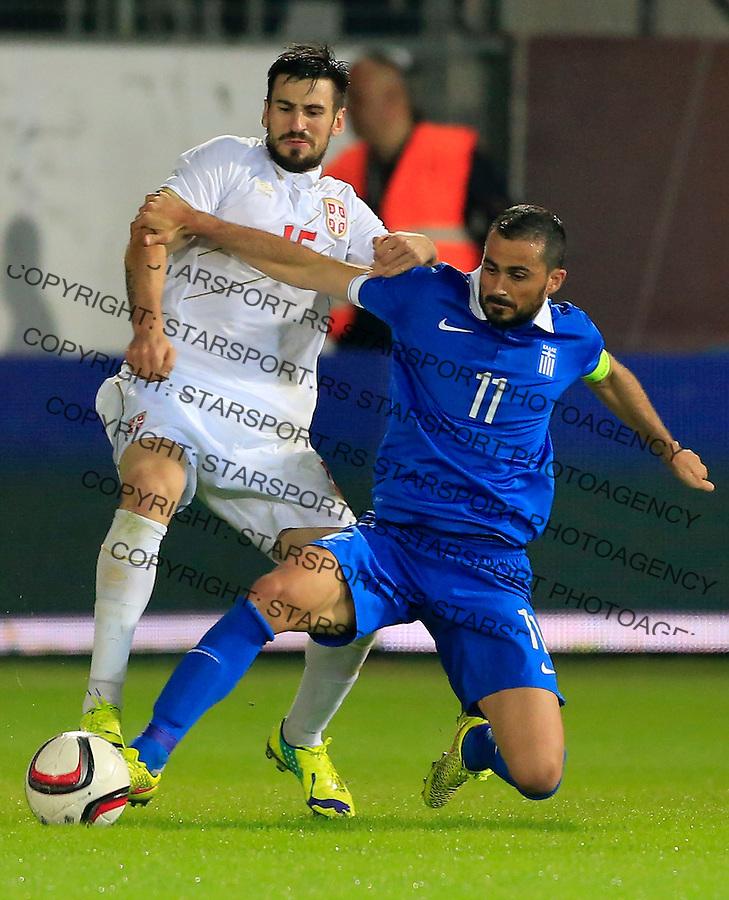 Fudbal<br /> Prijateljski mec-Friendly match<br /> Srbija v Grcka<br /> Nenad Tomovic (L) and Loukas Vyntra<br /> Chania, 18.11.2014.<br /> foto: Srdjan Stevanovic/Starsportphoto &copy;