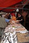 Wrapping fresh fish in Italian market, Venice, Italy, May 2007
