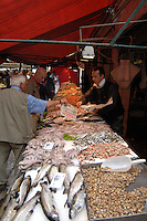 Wrapping fresh fish in Italian market, Venice, Italy, May 2007