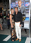 Kevin Costner, Christine Baumgartner attends The L.A. Premiere of Summit Entertainment's DRAFT DAY held at The Regency Village Theatre in Westwood, California on April 07,2014                                                                               © 2014 Hollywood Press Agency