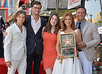 LOS ANGELES, CA. August 11, 2016: Roma Downey &amp; husband producer Mark Burnett &amp; children Reilly Marie Anspaugh, James &amp; Cameron Burnett at Hollywood Walk of Fame Star ceremony for actress Roma Downey. <br /> Picture: Paul Smith / Featureflash