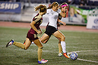 Penn's Kristina Lynch (24) cuts between Brebeuf Jesuit defenders before scoring a goal during the IHSAA Class 2A Girls Soccer State Championship Game on Saturday, Oct. 29, 2016, at Carroll Stadium in Indianapolis. Special to the Tribune/JAMES BROSHER