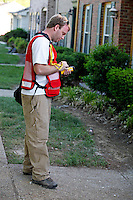 Red Cross volunteer Erik T. Rumbaugh records how high the waters reached in homes on Todd Preis Drive in the Nashville suburb of Bellevue on Saturday, May 8, 2010.