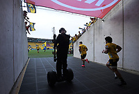 Skysport steadicam operator Rhys Duncan films the Hurricanes running out for the Super Rugby match between the Hurricanes and Sharks at Sky Stadium in Wellington, New Zealand on Saturday, 15 February 2020. Photo: Dave Lintott / lintottphoto.co.nz