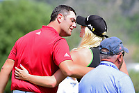Jon Rahm (ESP) and his girlfriend Kelley Cahill kiss as they depart the 16th green following round 6 of the World Golf Championships, Dell Technologies Match Play, Austin Country Club, Austin, Texas, USA. 3/26/2017.<br /> Picture: Golffile | Ken Murray<br /> <br /> <br /> All photo usage must carry mandatory copyright credit (&copy; Golffile | Ken Murray)