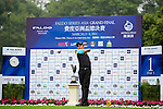 Lawrence Celestino of Philippines tees off on the 1st hole during the Round 1 of the Faldo Series Asia Grand Final at Mission Hills on March 2, 2011 in Shenzhen, China. Photo by Raf Sanchez / Faldo Series