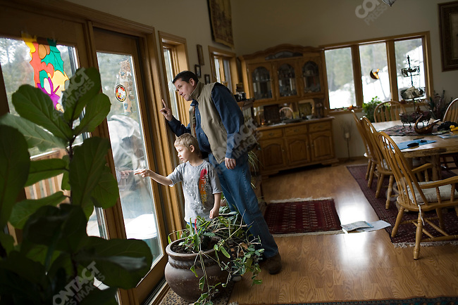 Stuart Walsh visits his son, Johnny, who is enrolled at the Ranch for Kids, a therapeutic boarding school located near Eureka, Montana for adopted foreign children who are experiencing difficulties, such as adoption disruption, with their new U.S. families. Johnny currently lives with Joyce Sterkel, the founder of the ranch. Montana, March 1, 2008.
