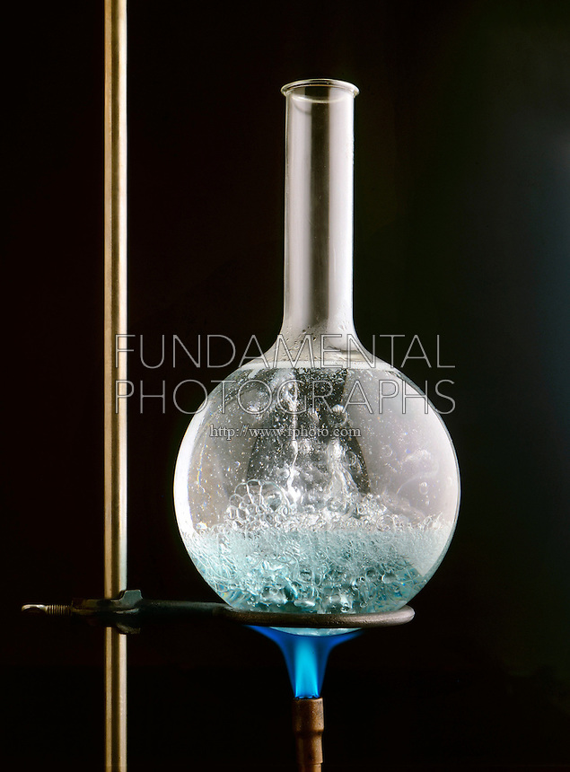 AQUEOUS SOLUTION IN BOILING FLASK (3 of 3)<br /> Propane Flame Heats H2O to Form Steam Bubbles<br /> Shows turbulence of solution at boiling point