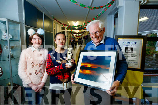 Presentation Secondary school Tralee Camera Club hosted the Ardfert Camera Club Exhibition in the school, they picked a winning photo from the exhibition and the award went to Chris Dennehy for a beautiful sunset photo, the award was in memory of Ardfert camera club member Dylan Bowyer and presented by Megan Diggins, Jingwen Lin.