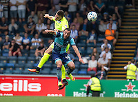 Ben Dickenson of Colchester United heads clear from Michael Harriman of Wycombe Wanderers during the Sky Bet League 2 match between Wycombe Wanderers and Colchester United at Adams Park, High Wycombe, England on 27 August 2016. Photo by Liam McAvoy.