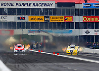 Apr 22, 2018; Baytown, TX, USA; NHRA funny car driver Bob Tasca III (left) races alongside Jonnie Lindberg during the Springnationals at Royal Purple Raceway. Mandatory Credit: Mark J. Rebilas-USA TODAY Sports