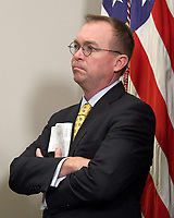 Director of the Office of Management and Budget Mick Mulvaney attends the ceremony where United States President Donald J. Trump will sign an Executive Order to promote healthcare choice and competition in the Roosevelt Room of the White House in Washington, DC on Thursday, October 12, 2017.  The President's controversial plan is designed to make lower-premium health insurance plans more widely available.<br /> Credit: Ron Sachs / Pool via CNP /MediaPunch