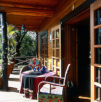 French windows open from the living room onto the veranda which is a perfect spot to sit and read, relax and eat