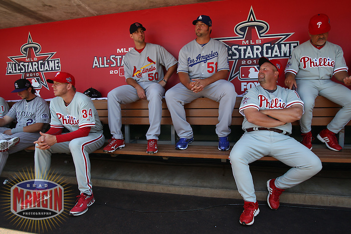 ANAHEIM - JULY 13:  Roy Halladay, Adam Wainwright, Jonathan Broxton, coach Mick Billmeyer and coach Davey Lopes of the National League sit in the dugout before the All Star Game at Angel Stadium on June 13, 2010 in Anaheim, California. Photo by Brad Mangin