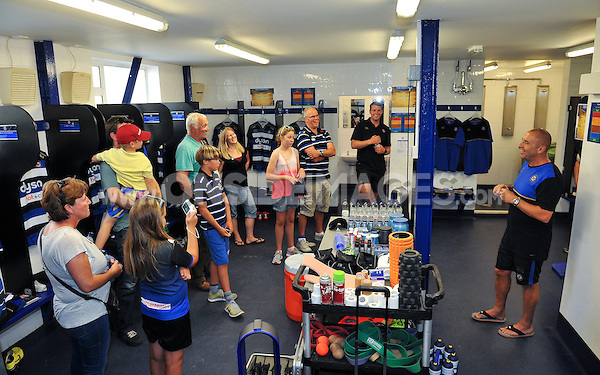 Kit Manager Steve Middleton gives a talk on matchday preparation to supporters in the Bath Rugby changing rooms. Bath Rugby Family Festival of Rugby, on August 8, 2015 at the Recreation Ground in Bath, England. Photo by: Patrick Khachfe / Onside Images