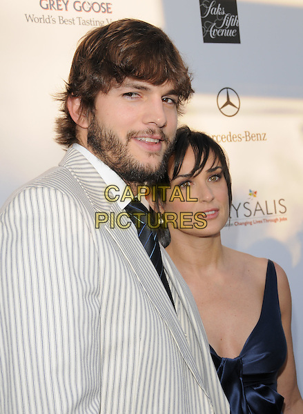 ASHTON KUTCHER & DEMI MOORE.Attending The 7th Annual Chrysalis Butterfly Ball held at a private estate in Brentwood, California, USA,.May 31st 2008                                                                     .half length blue bow dress tie beard couple striped white jacket suit married husband wife.CAP/DVS.©Debbie VanStory/Capital Pictures