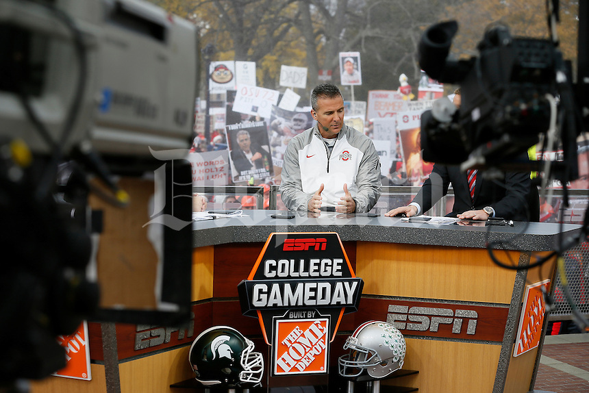 Ohio State Buckeyes head coach Urban Meyer talks on the set of ESPN's College GameDay broadcast from the campus of Ohio State prior to the NCAA football game against the Michigan State Spartans in Columbus on Nov. 21, 2015. (Adam Cairns / The Columbus Dispatch)