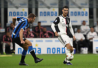 Calcio, Serie A: Inter Milano - Juventus, Giuseppe Meazza stadium, October 6 2019.<br /> Juventus' Cristiano Ronaldo (r) in action with Inter's Stefan de Vrij (l) during the Italian Serie A football match between Inter and Juventus at Giuseppe Meazza (San Siro) stadium, October 6, 2019.<br /> UPDATE IMAGES PRESS/Isabella Bonotto
