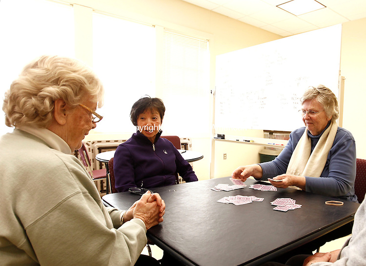 Woodbury, CT- 25 March 2014-032514CM03-  Left to right, Jean Burnham, of Southbury, Gracie Baldovi of Wolcott, and Carol Gereg, of Woodbury, play a game of Bridge with, Carlys Burghart, of Woodbury (off camera) at the Woodbury Senior Center on Monday.  The group just finished an intermediate class on the game, which included defensive moves and strategies.  The course runs ten weeks at the center.   Christopher Massa Republican-American