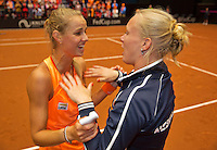 Netherlands, Den Bosch, April 18 2015 Maaspoort, Fedcup Netherlands-Australia,  Arantxa Rus (NED)  is celebrating with captain Kiki Bertens, Australia is eliminated<br /> Photo: Tennisimages/Henk Koster