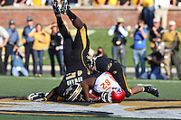 MU safety Del Howard goes head-over-heals as he and cornerback Castine Bridges tackle Iowa State Cyclones wide receiver Marquis Hamilton on an eight yard pass during the third quarter at Memorial Stadium in Columbia, Missouri on October 27, 2007. The Tigers won 42-28.