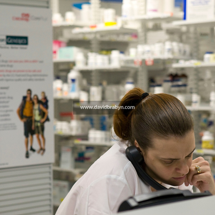 Pharmacy technician Lori Enright works in the pharmacy at the Pitney Bowes headquarters in Stamford, CT, United States, 7 October 2008.