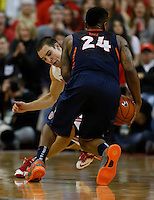 Ohio State Buckeyes guard Aaron Craft (4) attempts a steal on Illinois Fighting Illini guard Rayvonte Rice (24) in the second half at Value City Arena in Columbus Jan. 23, 2013 (Dispatch photo by Eric Albrecht)