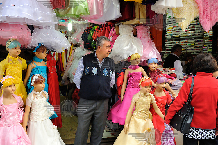 A shop selling girls dresses, modelled on child dummies, in Eminonu District.