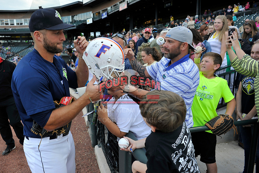 Left fielder Tim Tebow (15) of the Columbia Fireflies signs a Florida Gators helmet before a game against the Lakewood BlueClaws on Saturday, May 6, 2017, at Spirit Communications Park in Columbia, South Carolina. Lakewood won, 1-0 with a no-hitter. (Tom Priddy/Four Seam Images)
